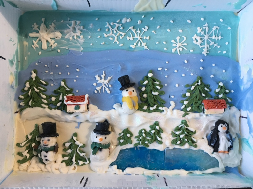 Christmas soap in slab mold featuring a frozen lake, snowflakes, a penguin, pine treees, and a snowman