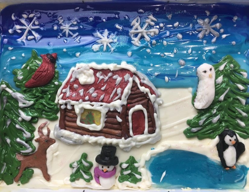 Christmas soap in slab mold featuring a frozen lake, snowflakes, a white owl, a penguin, a cabin, snowman and deer