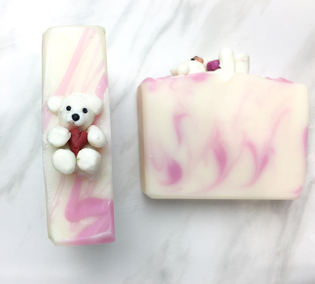 white and pink soap with white teddy bear soap as decoration