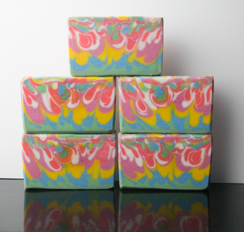 Colorful drop swirls Soaps with dark orange, pink, yellow, green and blue colors.