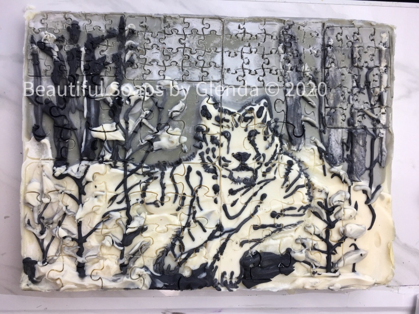 White and black soap, with bengal tiger in slab mold, puzzle soap